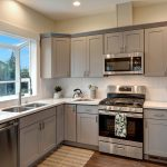 Beautiful new kitchen has quartz counters, tile backsplash, gas cooking and soft-close cabinetry.