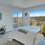 Master Suite opens to view deck. Double closets PLUS Walk-in closet, all with organizers. Spa Bath with soaking tub overlooks panoramas of lake, sky, mountains and forest.
