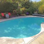 In-Ground Pool has in-line chlorinator and Automatic Security Pool Cover, rated for 285lb Static Load. Pool resurfaced 2015, new pump 2016.